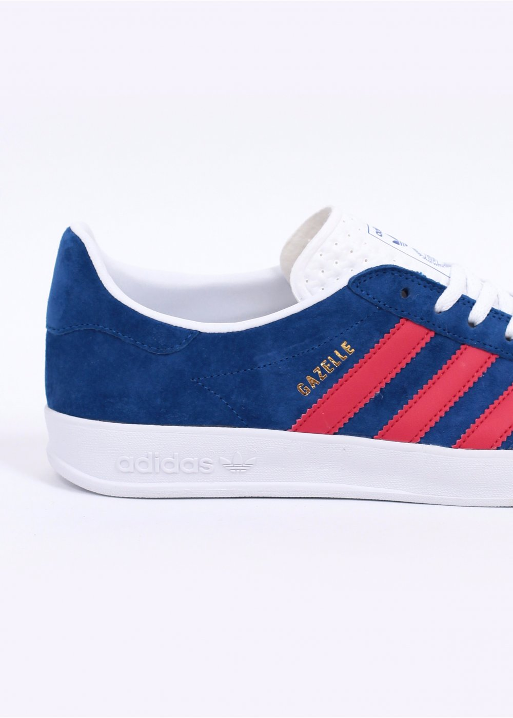 blue and red adidas gazelles