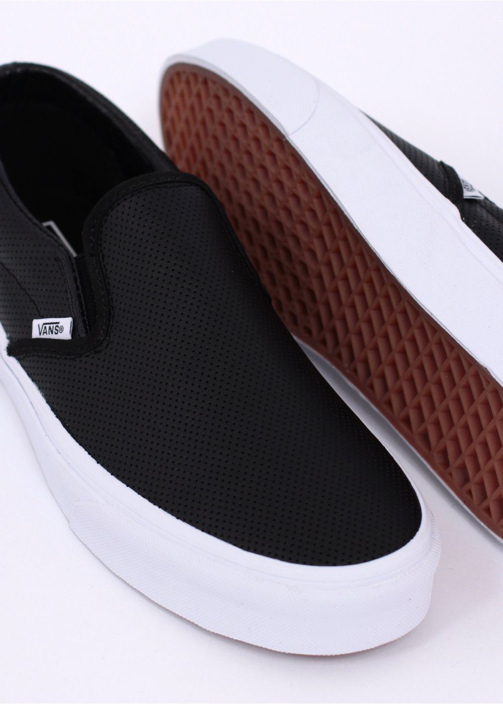 vans classic black perforated leather slip on