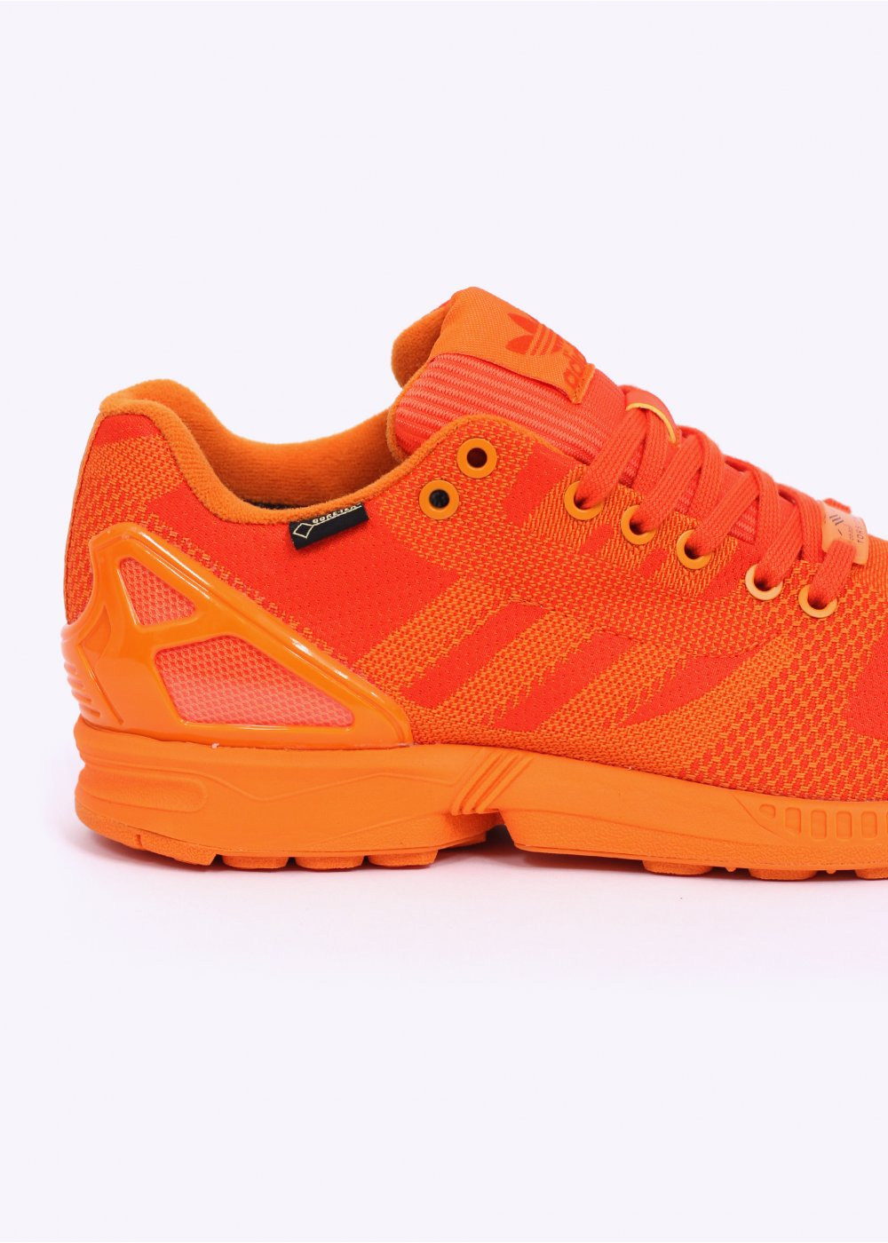 bright orange adidas trainers