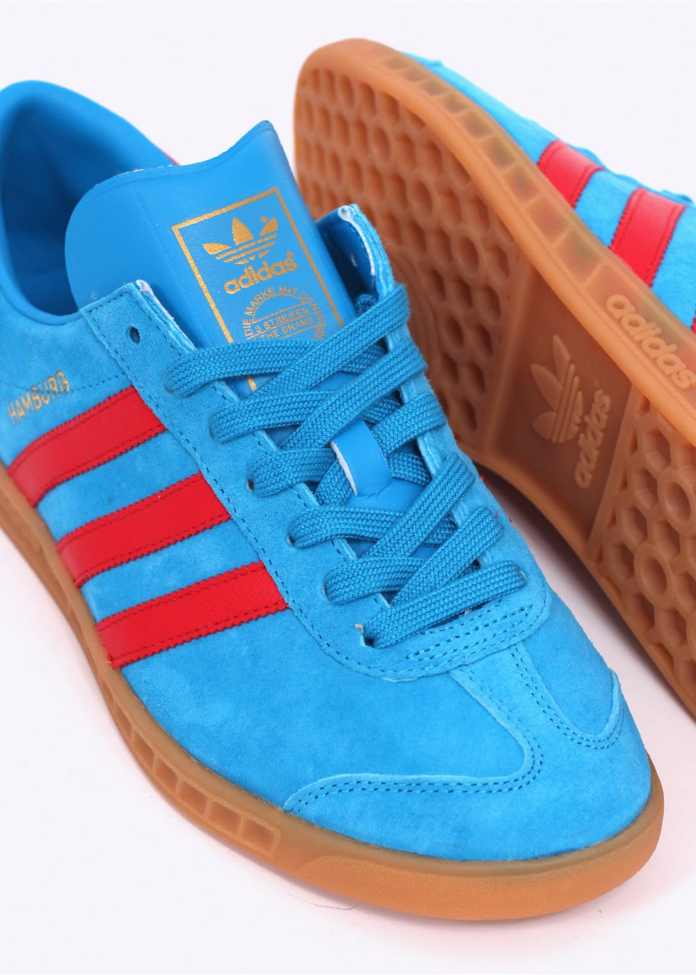Realista tolerancia cafetería  adidas hamburg blue and red online -